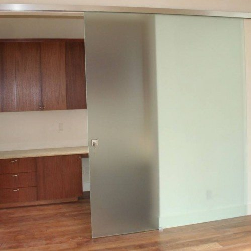 Dorma Agile Sliding Barn Door Style Door Used for Bedroom Closet | Sliding Barn Doors | Residential Product Gallery | Anchor-Ventana Glass Company
