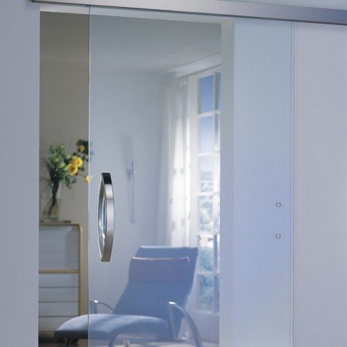 Dorma Agile Sliding Barn Door Style Door Separating Sun Room & Living Room | Sliding Barn Doors | Residential Product Gallery | Anchor-Ventana Glass Company