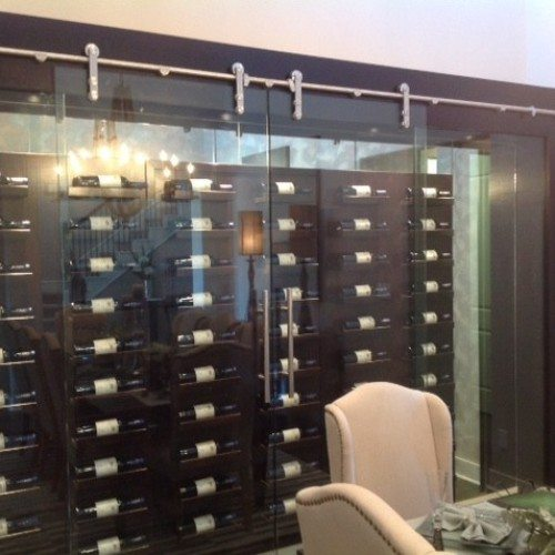 Dorma Manet Sliding Doors and Wall Seperating the Wine Room and Dining Room | Glass Wall Systems Gallery | Interior Glass Products | Anchor-Ventana Glass