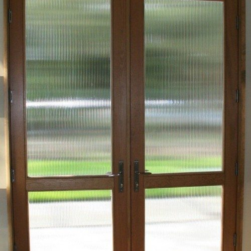 Reeded Glass Set in Wood Entry Doors | Entrances Gallery | Commercial Products | Anchor-Ventana Glass