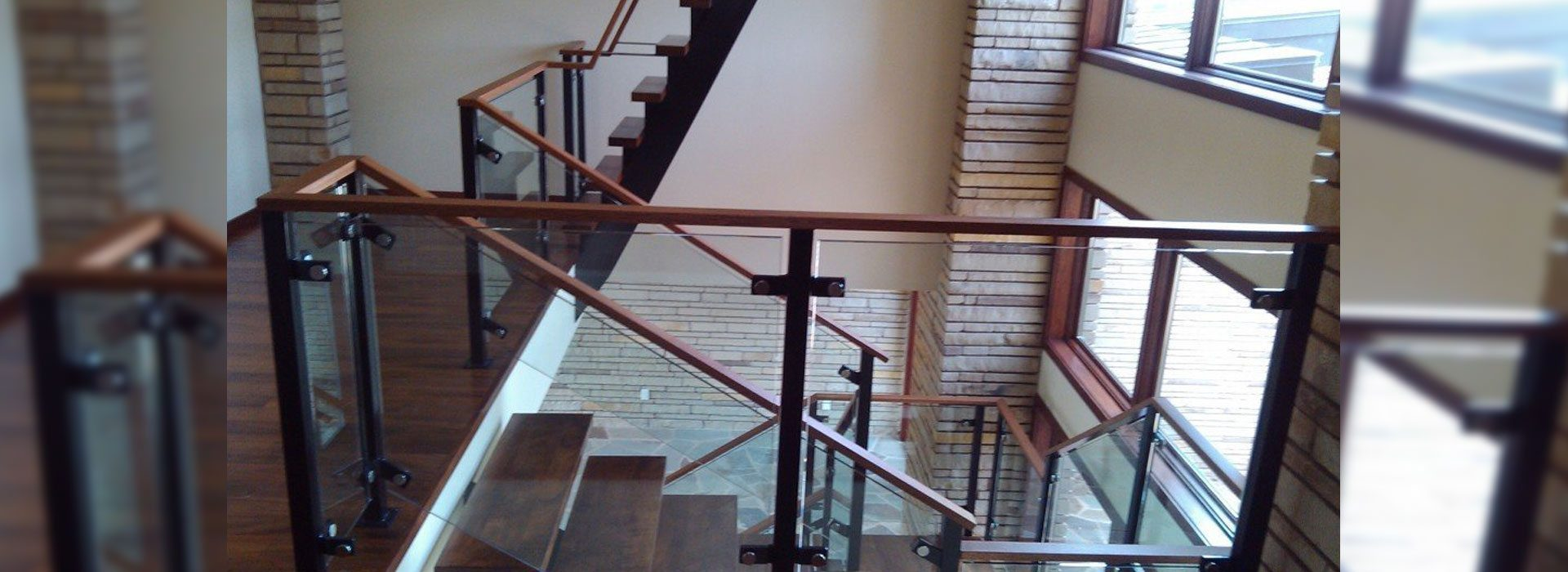 Commercial Building Interior with Glass Handrails for Staircase paired with Wood | Commercial Glass Handrail Products | Commercial Products | Anchor-Ventana Glass