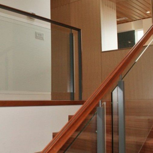 Custom Glass Handrail with Standoff Hardware in Stairway | Commercial Glass Handrails | Commercial Products | Anchor-Ventana Glass