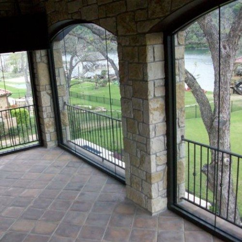 Arched Butt Glazed Windows on Enclosed Balcony | Glass Wall Systems Gallery | Residential Products | Anchor-Ventana Glass
