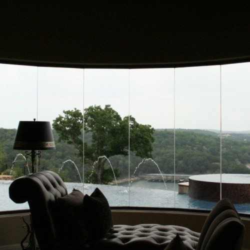 Butt Glazed Angle Cut Window at Living Room & Pool Area | Glass Wall Systems Gallery | Residential Products | Anchor-Ventana Glass