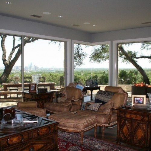 Frameless Corner Butt Glazed Window Separating Living room & Patio | Glass Wall Systems Gallery | Residential Products | Anchor-Ventana Glass