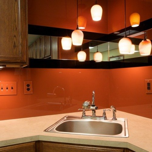 Back Painted Glass & Mirror Backsplash with Outlet Covers in kitchen | Colored Glass Gallery | Residential Products | Anchor-Ventana Glass