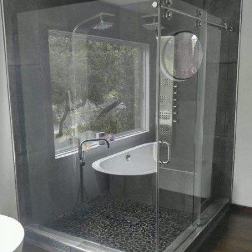 Contemporary Frameless Sliding Shower Enclosure in Bathroom | Sliding Shower Enclosures Gallery | Residential Products | Anchor-Ventana Glass