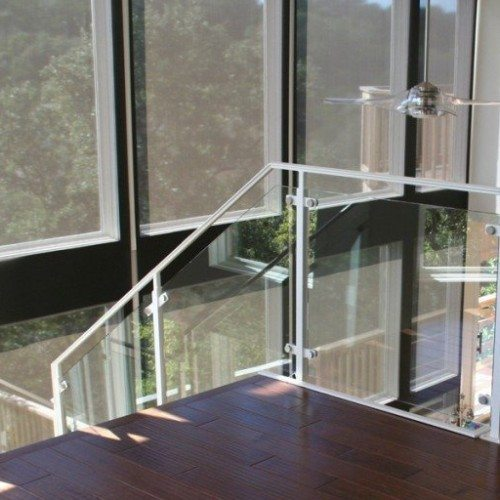 Custom Glass Handrail with Standoff System in Stairway | Glass Handrail Systems | Residential Gallery | Anchor-Ventana Glass