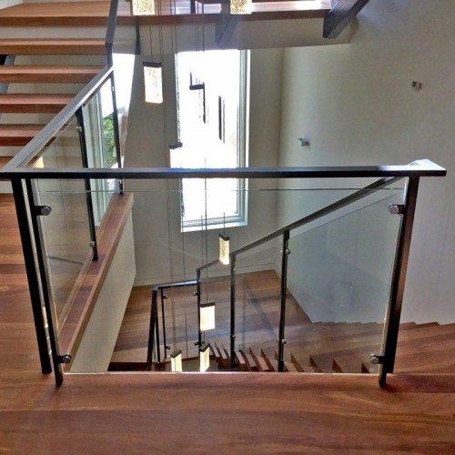 Interior Glass Handrail System on Winding Staircase | Glass Handrail Systems | Residential Gallery | Anchor-Ventana Glass