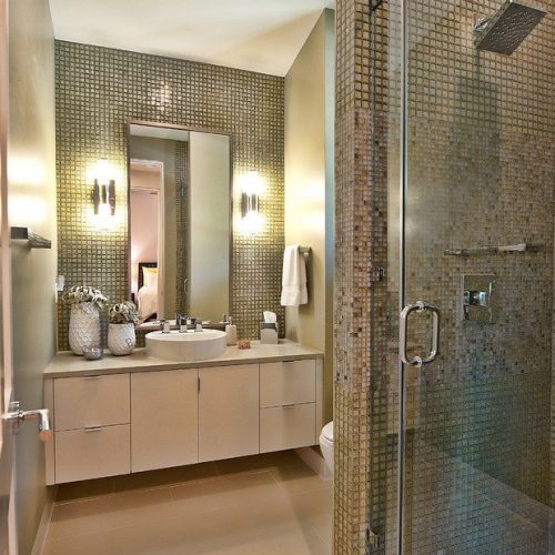 Vanity Mirror with J-mold on All Sides and Frameless Shower Enclosure in Bathroom | Mirrors Gallery | Anchor-Ventana Glass