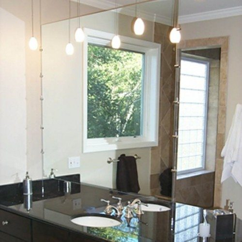 Frameless Vanity Mirror Suspended with Cable System in Bathroom | Mirrors Gallery | Anchor-Ventana Glass