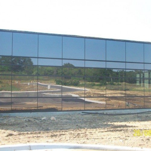 Exterior View of Glass Curtain Wall System with SSG Verticals | STAR Park at Texas State University | Commercial Projects | Anchor-Ventana