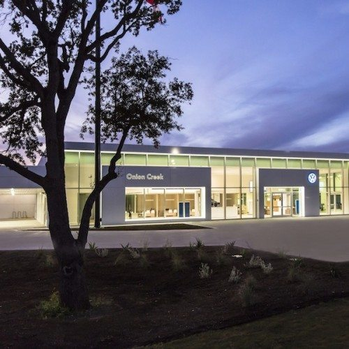 Exterior View of Glass Curtain Wall System & Storefront Entrance | Onion Creek Volkswagen | Commercial Projects | Anchor-Ventana Glass