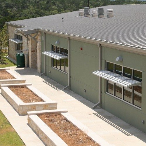 Exterior View of Glass Windows with Sunshades from Above | Lake Travis Middle School | Commercial Projects | Anchor-Ventana