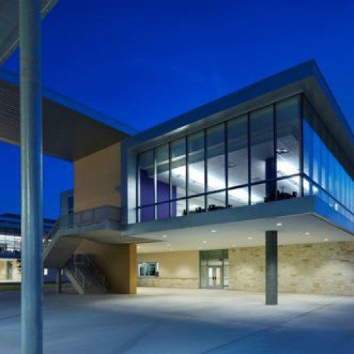 Exterior View of Curtain Wall System At Night | Cedar Ridge High School | Commercial Projects | Anchor-Ventana Glass