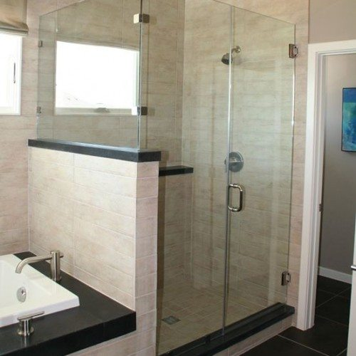 Frameless Corner Shower Enclosure with Channel on Fixed Panels in Bathroom | Shower Gallery | Anchor-Ventana Glass