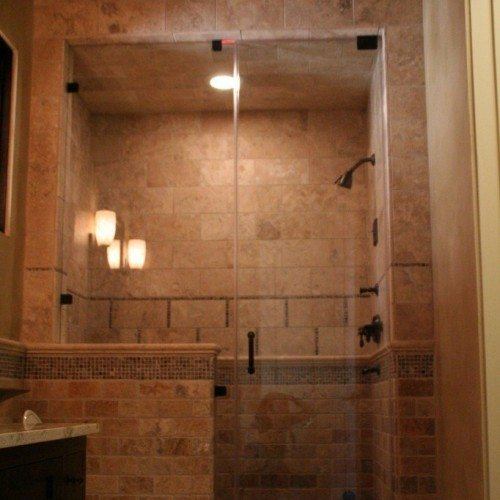 Frameless Inline Steam Enclosure with Pivots on Door and Clamps on Notched Panel in Bathroom Shower   Shower Gallery   Anchor-Ventana Glass