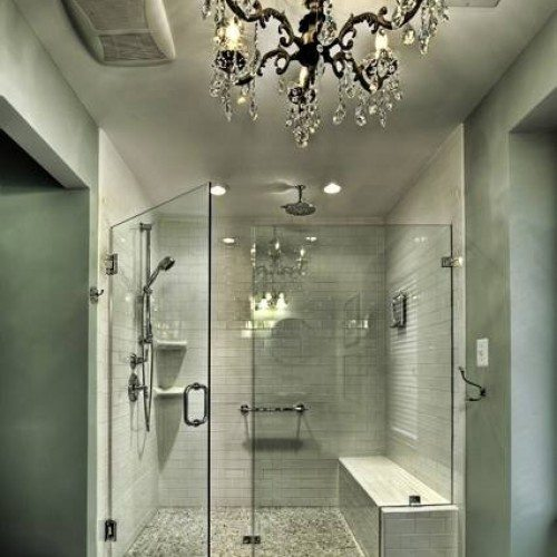 Frameless Shower Enclosure with Clamps at Notched Fixed Panel in Bathroom   Shower Gallery   Anchor-Ventana Glass