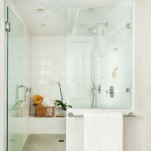 Frameless Shower Door with Hinges and Fixed Panel with Clamps in Bathroom | Shower Gallery | Anchor-Ventana Glass