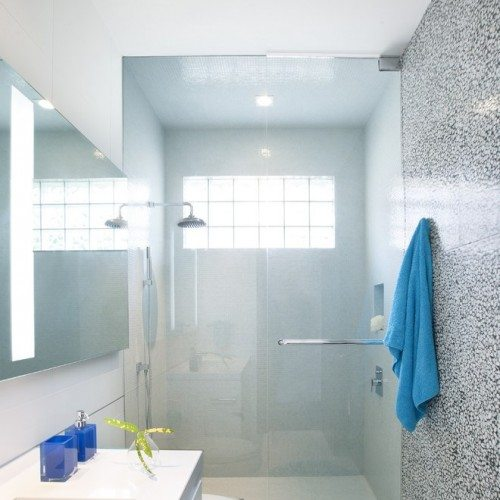 Bright contemporary bathroom with clear glass shower door and large mirror | Shower Gallery | Anchor-Ventana Glass Design