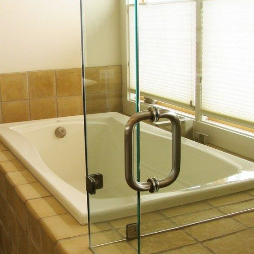 Frameless Corner Shower Enclosure with Clamps at Fixed Panels in Bathroom   Shower Gallery   Anchor-Ventana Glass