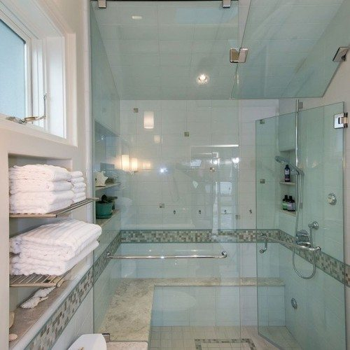 Unique frameless glass shower door and walls in contemporary bathroom | Shower Gallery | Anchor-Ventana Glass