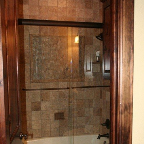 Frameless Sliding Tub Shower Enclosure in Bathroom | Shower Gallery | Anchor-Ventana Glass