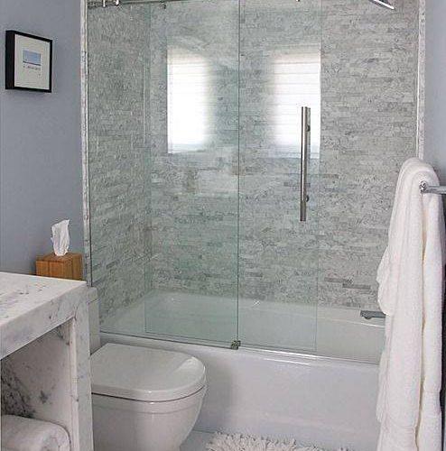 sliding glass shower door in white bathroom